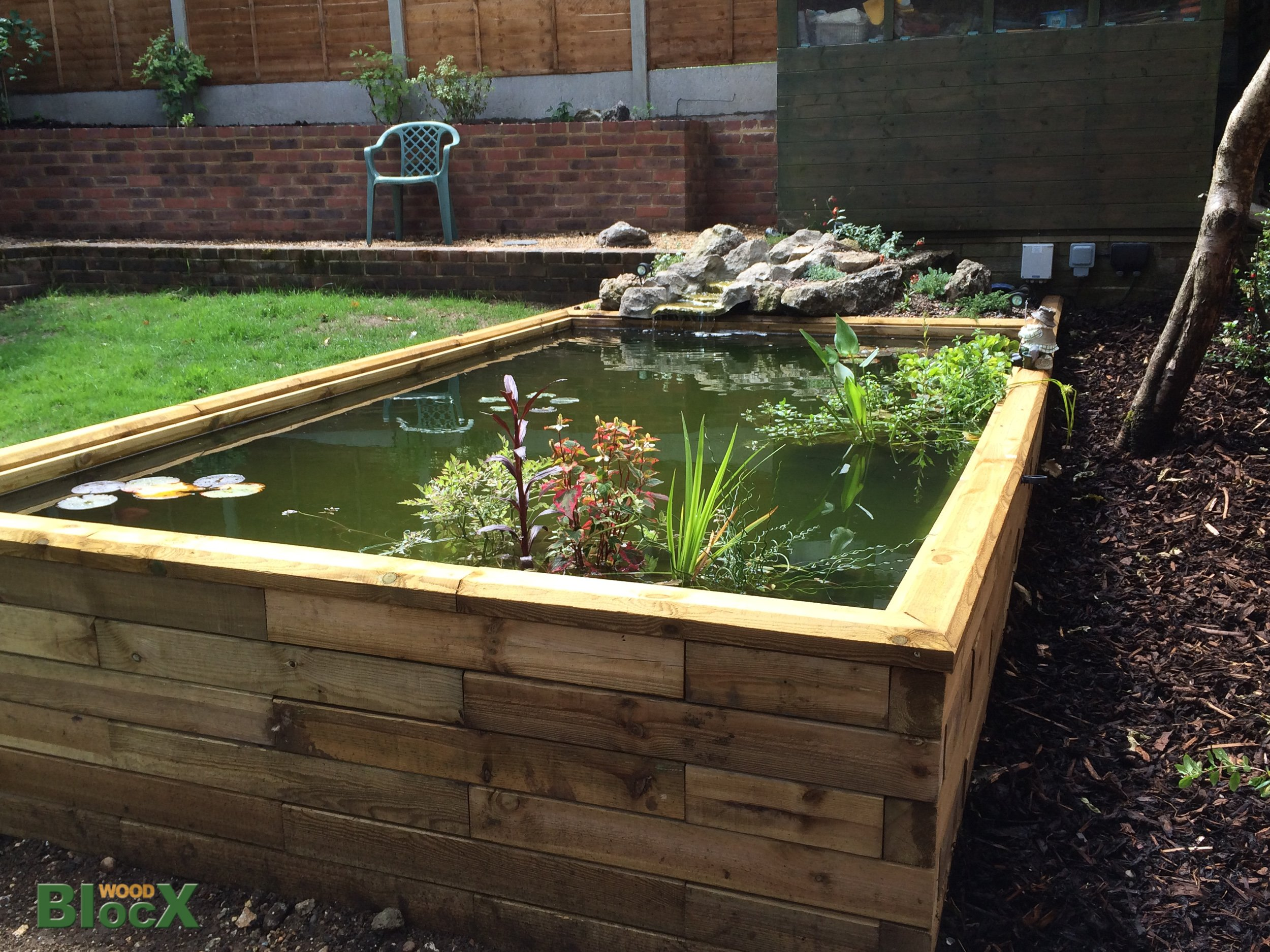 Garden pond kits using woodblocx and raised beds woodblocx for Koi pond kits home depot